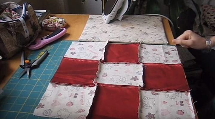 doblar las cruces para funda de cojin con patchwork
